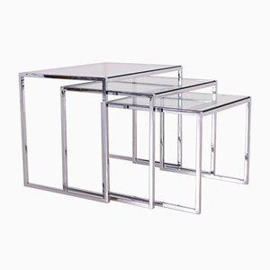 Juego de mesas nido modernistas de vidrio y cromo, años 70