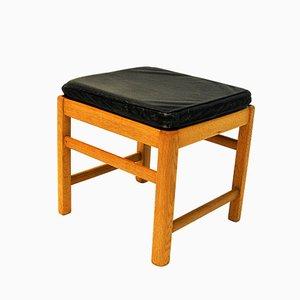 Taburete escandinavo de roble con asiento de cuero negro, años 60