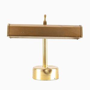 Lámpara de mesa dorada de Kaiser Idell, años 60