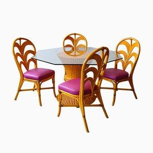 Juego de mesa y cuatro sillas de bambú de McGuire, años 80