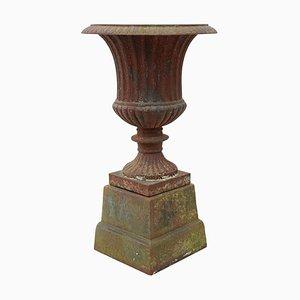 Maceta o urna estilo antiguo de hierro fundido con pedestal, años 90