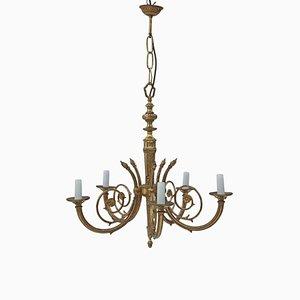 Lámpara de araña vintage antigua de latón y bronce dorado