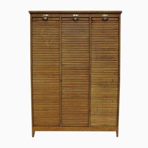 Mueble de roble con cierre de persiana triple, años 30