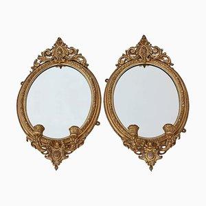 Espejos de pared Girandole antiguos dorados. Juego de 2