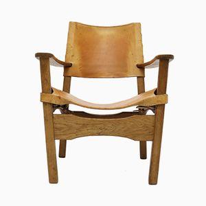 Dänischer Armlehnstuhl aus Sattelleder und Eichenholz, 1960er