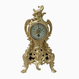 Orologio da camino rococò in metallo dorato, Francia, fine XIX secolo