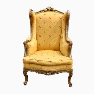 Antiker französischer Sessel mit vergoldetem Holzgestell & gelbem Stoffbezug