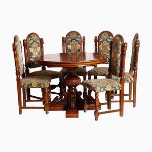Juego de mesa extensible y 6 sillas de nogal tallado de Bassano's Ebanistery, años 20