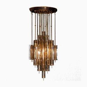 Lámpara de araña de latón y cristal ahumado de Verner Panton para J. Lüber, años 60