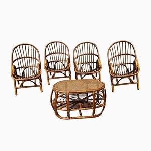 Juego de jardín formado por una mesa de centro y cuatro sillas de bambú y ratán, años 80