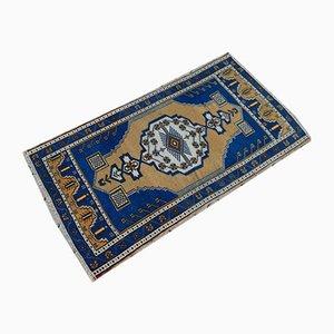 Alfombra turca vintage pequeña de tejido plano