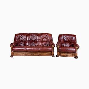 Juego de sofá y butaca de roble y cuero burdeos, años 60