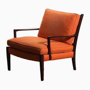 Sedia Löven in tessuto arancione di Arne Norell per Arne Norell AB, anni '70
