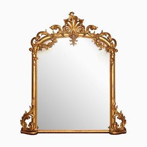 Espejo antiguo dorado tallado y ornamentado, década de 1860