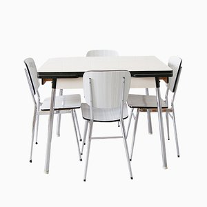 Tavolo da cucina vintage in formica con quattro sedie, anni '60