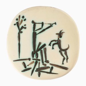 Plato con flautista y cabra de Pablo Picasso para Madoura, 1956