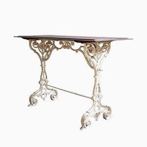 Mesa de jardín francesa ornamental antigua con superficie de madera