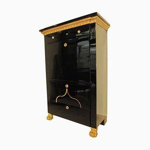 Secretaire Impero in acero ebanizzato con cornice placcata in oro