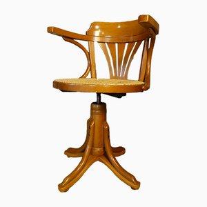 Silla giratoria con asiento de ratán, años 70