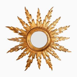 Spiegel mit geschnitztem & vergoldetem Holzrahmen in Sonnen-Optik