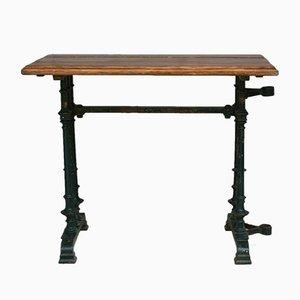 Mesa de bistrot francesa antigua con marco de hierro fundido