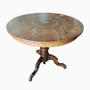 Mesa de comedor antigua con pedestal