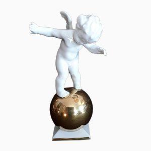 Puttofigur aus Porzellan auf goldenem Ball von Karl Tutter für Hutschenreuther, 1930er