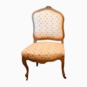 Antiker Stuhl mit lackiertem Holzgestell im Louis XV-Stil