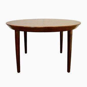 Mesa de comedor extensible danesa vintage redonda de palisandro, años 60
