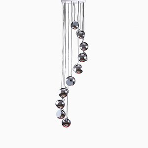 Lámpara de araña en cascada de metal cromado con 10 puntos de luz de Meblo & Guzzini, años 70