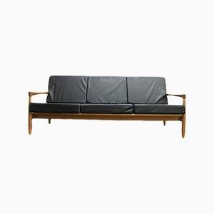 Sofá de tres plazas de roble y cuero de Erik Wørts, años 60