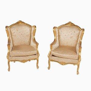 Butacas estilo Louis XV antiguas doradas. Juego de 2