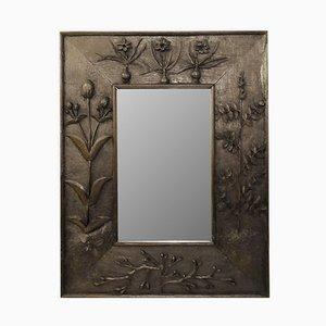 Espejo con marco de madera tallada