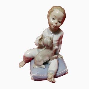 Statuetta di bambino e cane in porcellana di Fulgencio Garcia per Nao de Lladró, anni '80