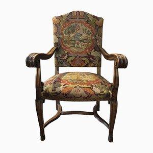 Antiker Armlehnstuhl aus Nussholz & Stoff