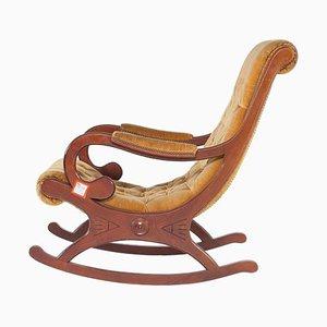 Sedia a dondolo antica in teak
