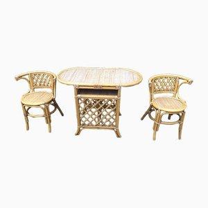 Juego de mesa y sillas de ratán, años 70