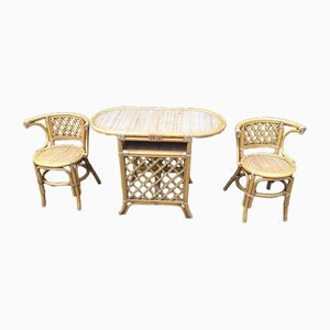 Tavolo in vimini con sedie, anni '70