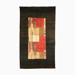 Tappeto vintage fatto a mano in lana
