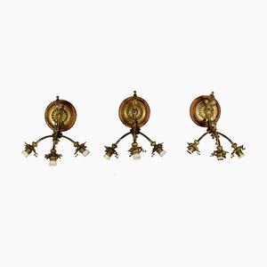Apliques antiguos de bronce tratado. Juego de 3