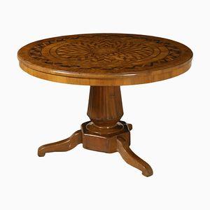 Runder antiker Tisch