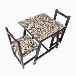 Juego de mesa y dos sillas infantil vintage, años 70