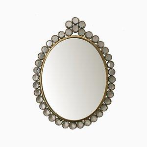 Espejo pequeño de vidrio y latón, años 30