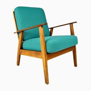 Dänischer Vintage Armlehnstuhl aus Teak & Eiche, 1950er
