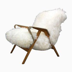 Art Deco Sessel mit Bezug aus Schafsfell von Tatra Nabytok