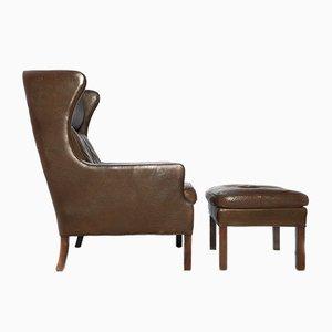 Juego de sillón y otomana vintage de cuero marrón, años 70