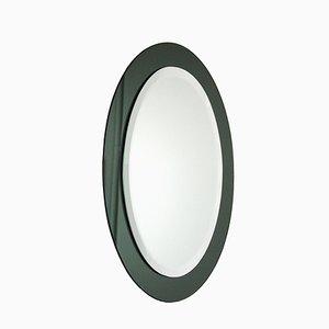 Espejo italiano ovalado de cristal ahumado verde, años 60