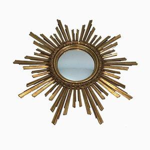 Espejo francés en forma de sol de madera dorada, años 70