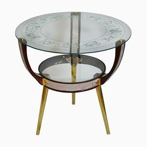 Mesa de centro con superficie de vidrio con los símbolos del zodiaco, años 50