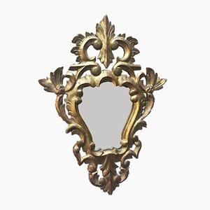 Antiker Spiegel im goldenen Rahmen